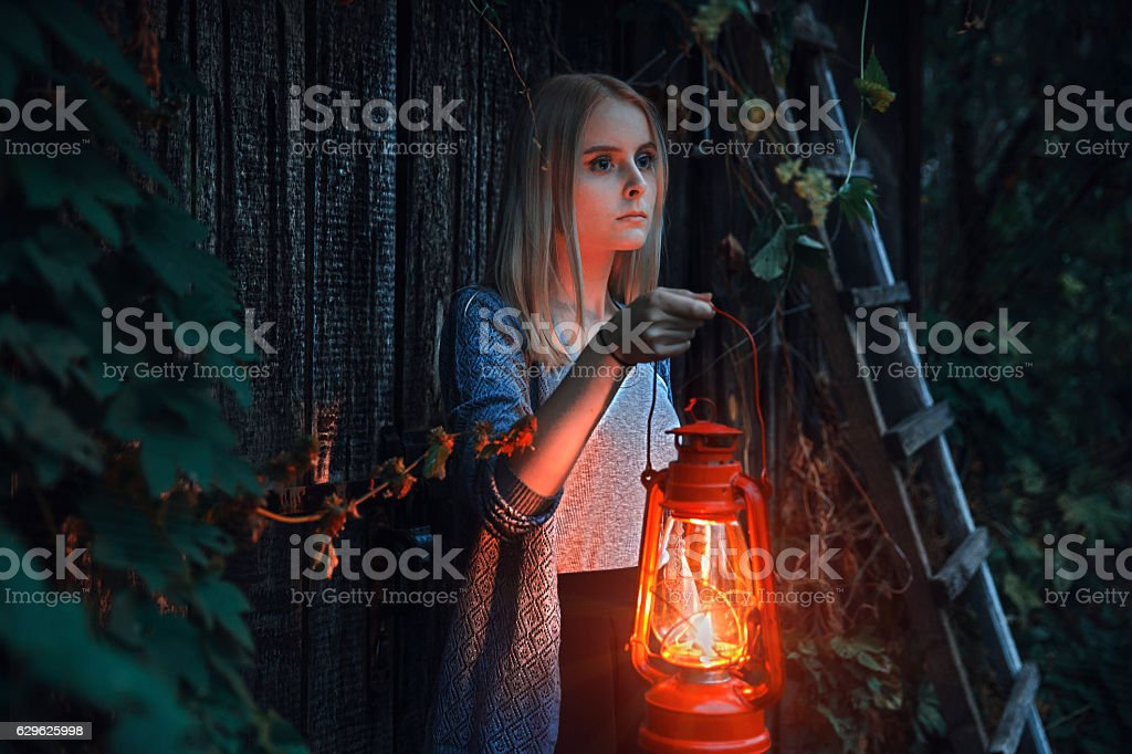 Young girl with lantern in fairy tale stock photo