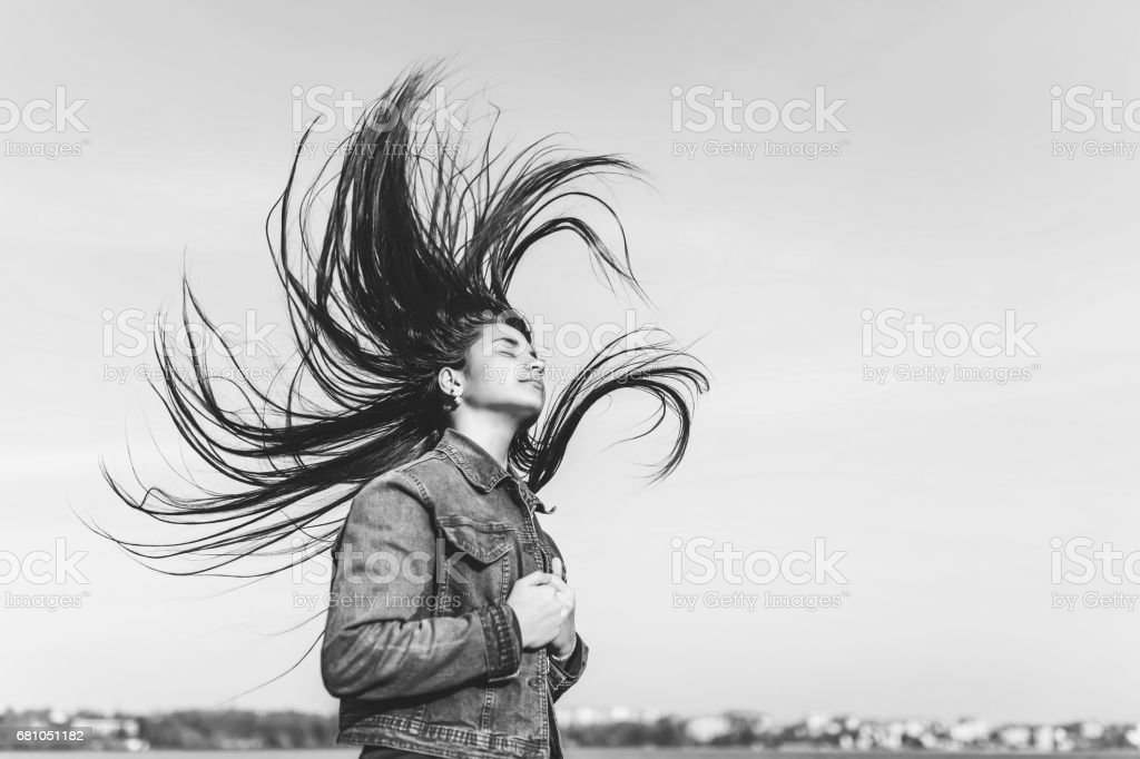 Young girl with long streaming hair royalty-free stock photo