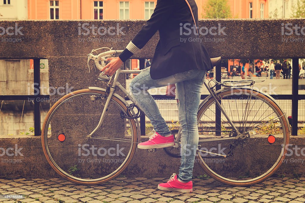 Young girl with old bicycle. stock photo