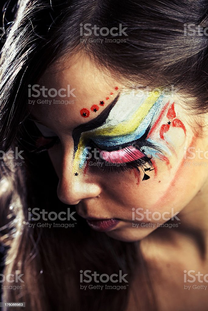 Young girl with ornate face makeup royalty-free stock photo