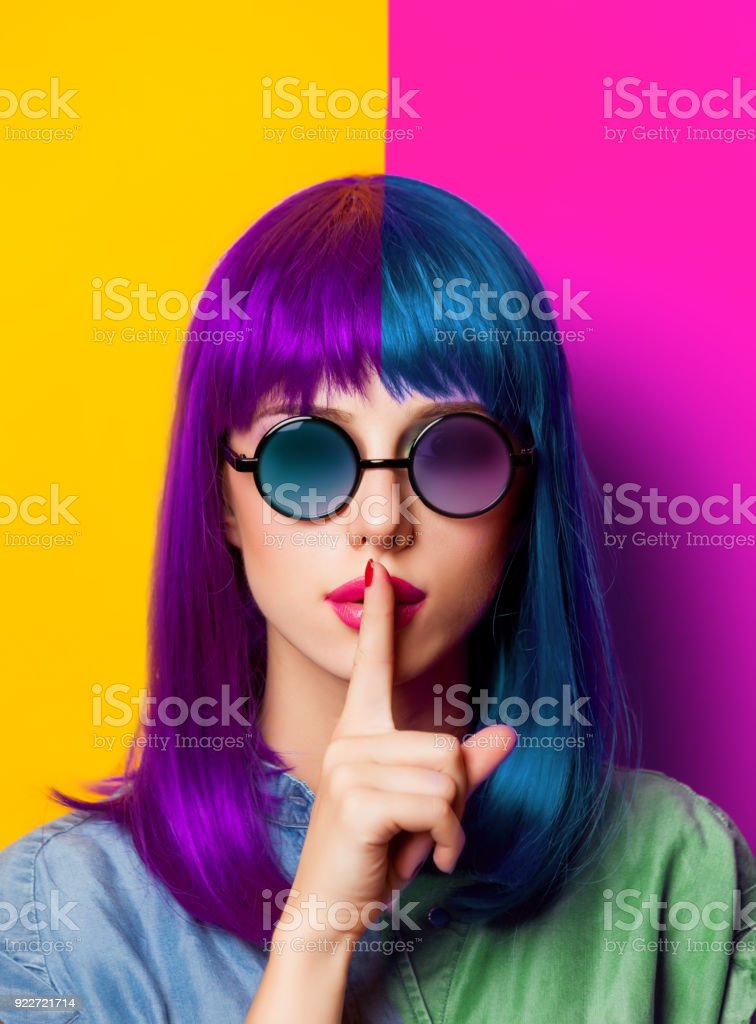 Young girl with purple hair and sunglasses stock photo