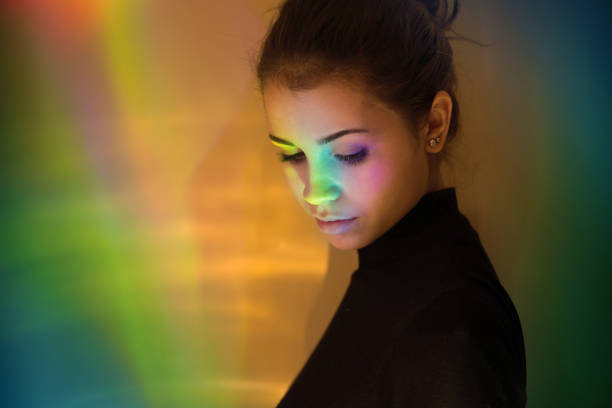 Young girl with rainbow reflections stock photo