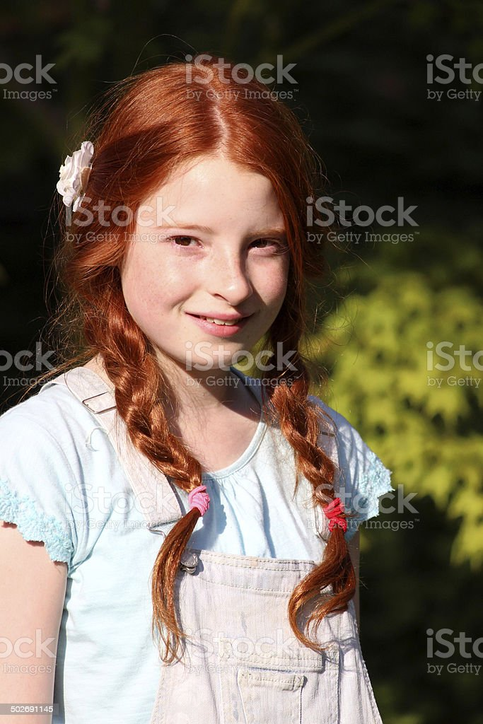 young girl with red hair stock photo image of forest young girl with red hair long pigtails plaits braided hair