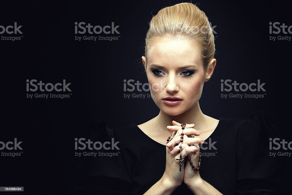 Young girl with Rosary Beads royalty-free stock photo