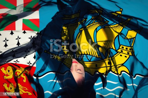 Beautiful woman laying in Saint-Pierre and Miquelon flag