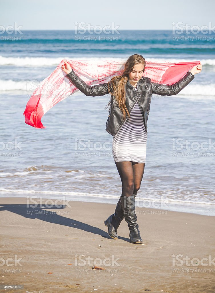 Young girl with scarf at the sea stock photo