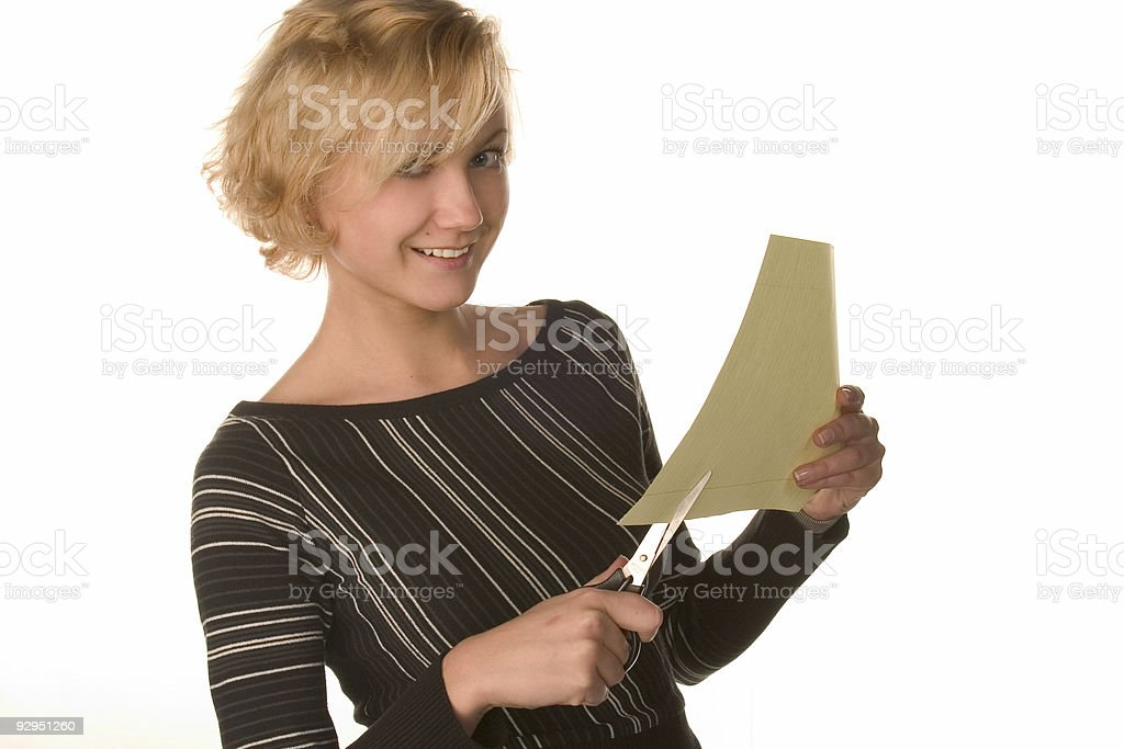 young girl with scissors and paper royalty-free stock photo