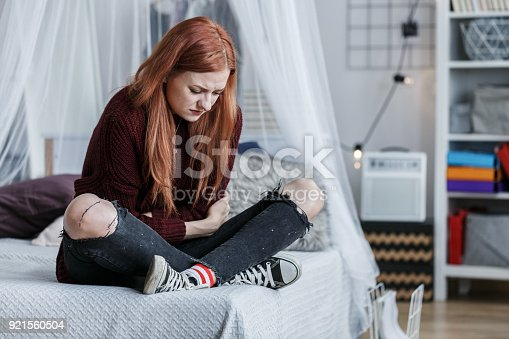 istock Young girl with stomach pain 921560504