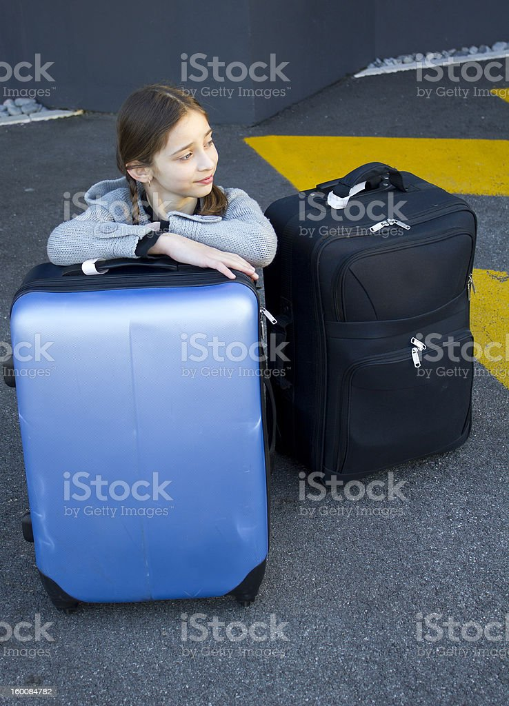 young girl with suitcases royalty-free stock photo