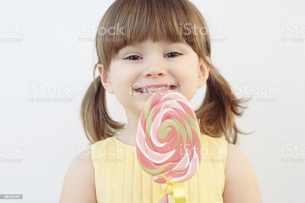 Young girl with swirled pink lolly pop royalty-free stock photo