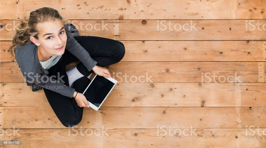 Young girl with tablet header mockup royalty-free stock photo
