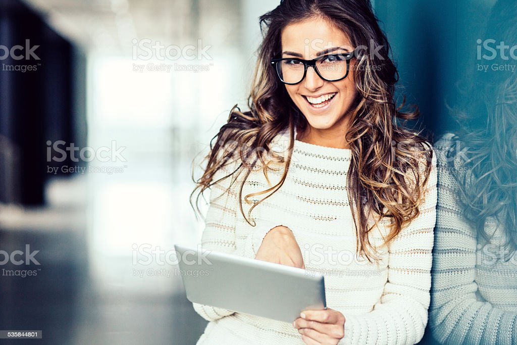 Young girl with tablet stock photo