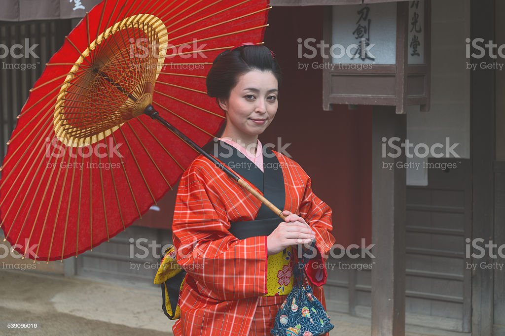 Young girl with the unbrella in the Edo period stock photo