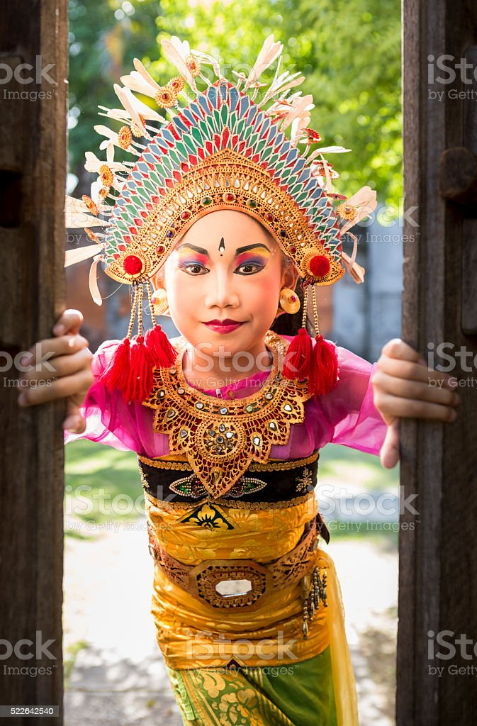 Young girl with traditional costume in a Bali temple stock photo