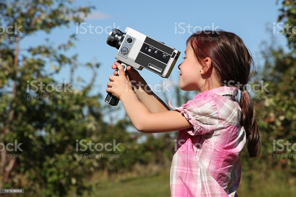 Young girl with video camera royalty-free stock photo