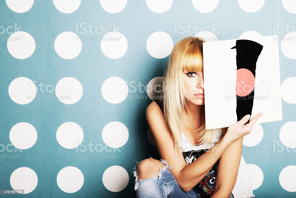 Young girl with vinyl records in the hands stock photo