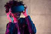 istock Young girl with VR goggles on head 669676798