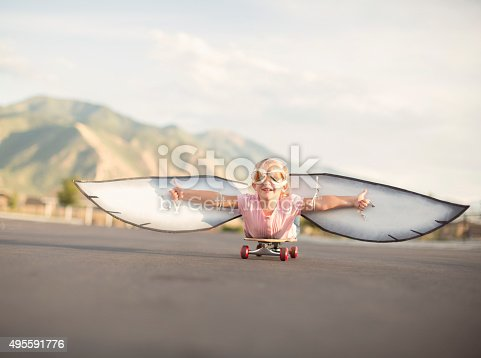 istock Young Girl with Wings Flies On Skateboard 495591776