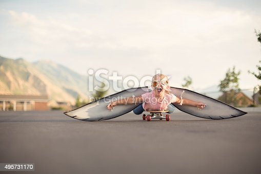 istock Young Girl with Wings Flies On Skateboard 495731170