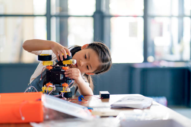 Young girl working on a robot design picture id964701210?b=1&k=6&m=964701210&s=612x612&w=0&h=evmii7oxcz3z9gclkvxwozbv r05n6j7q jkvpnq9rw=