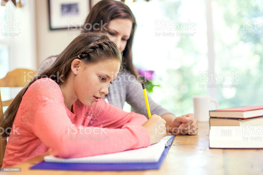 Young girl working on homework royaltyfri bildbanksbilder