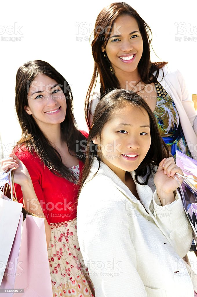 Young girlfriends shopping royalty-free stock photo