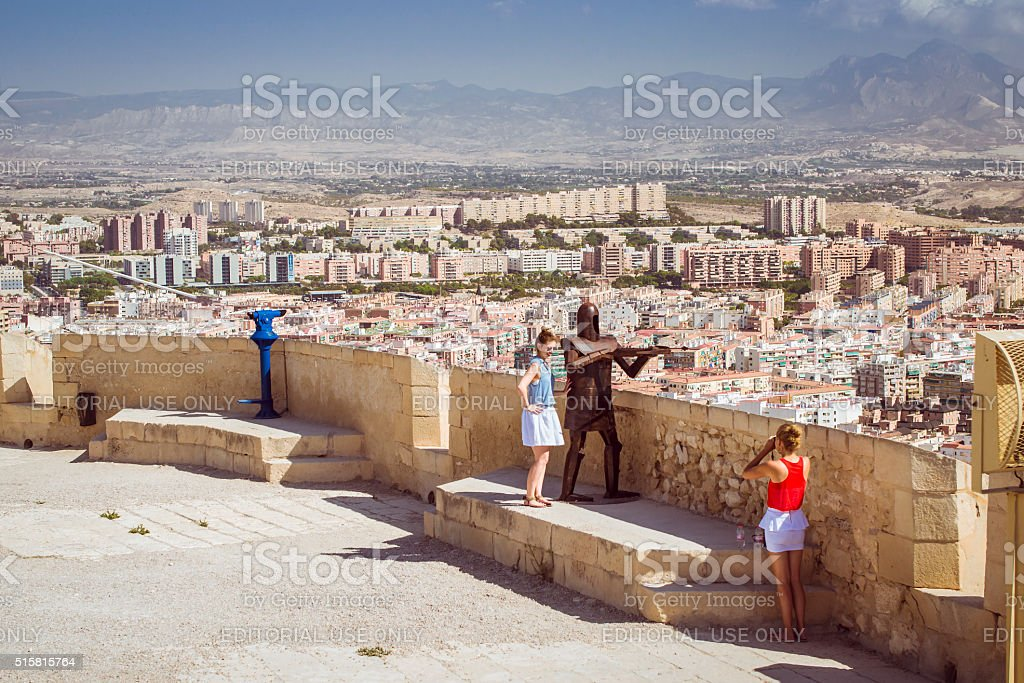 young girls are photographed on the background of fortress stock photo
