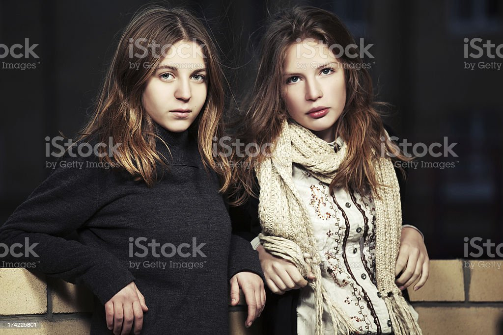 Young girls at the wall royalty-free stock photo