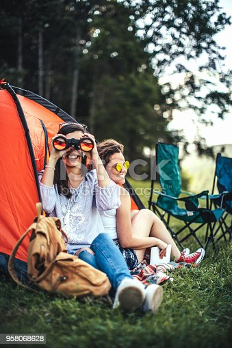 627343204 istock photo Young girls camping 958068628