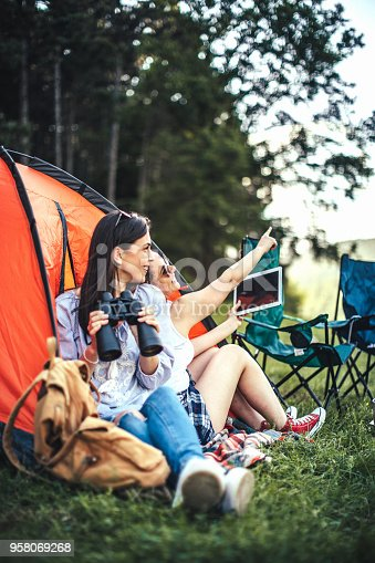 istock Young girls camping 958069268