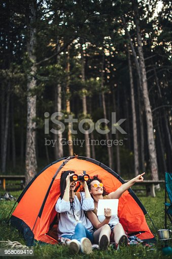 istock Young girls camping 958069410