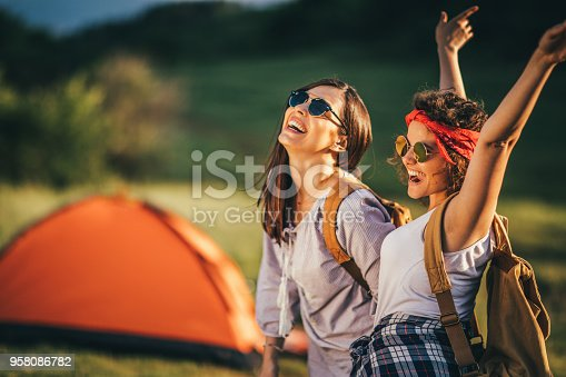 istock Young girls camping 958086782