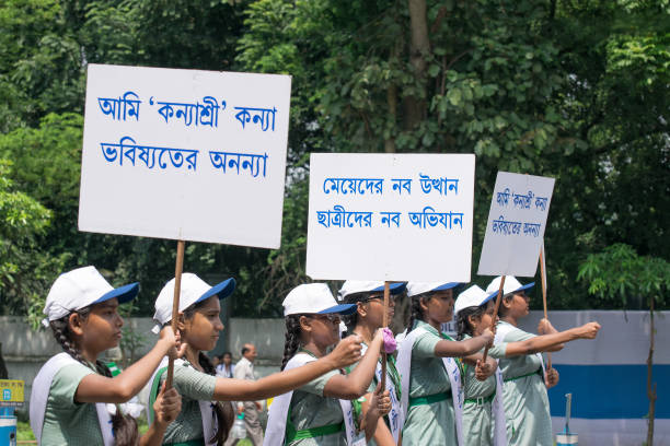 Young girls carrying Kanyashree placards stock photo