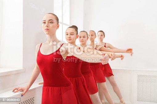 905560090 istock photo Young girls dancing ballet in studio 819686840
