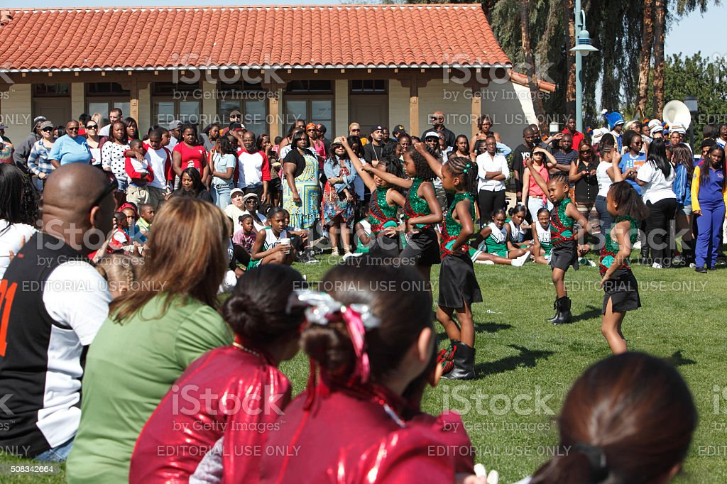 Young Girls Dancing Outdoors At Black History Celebration stock photo