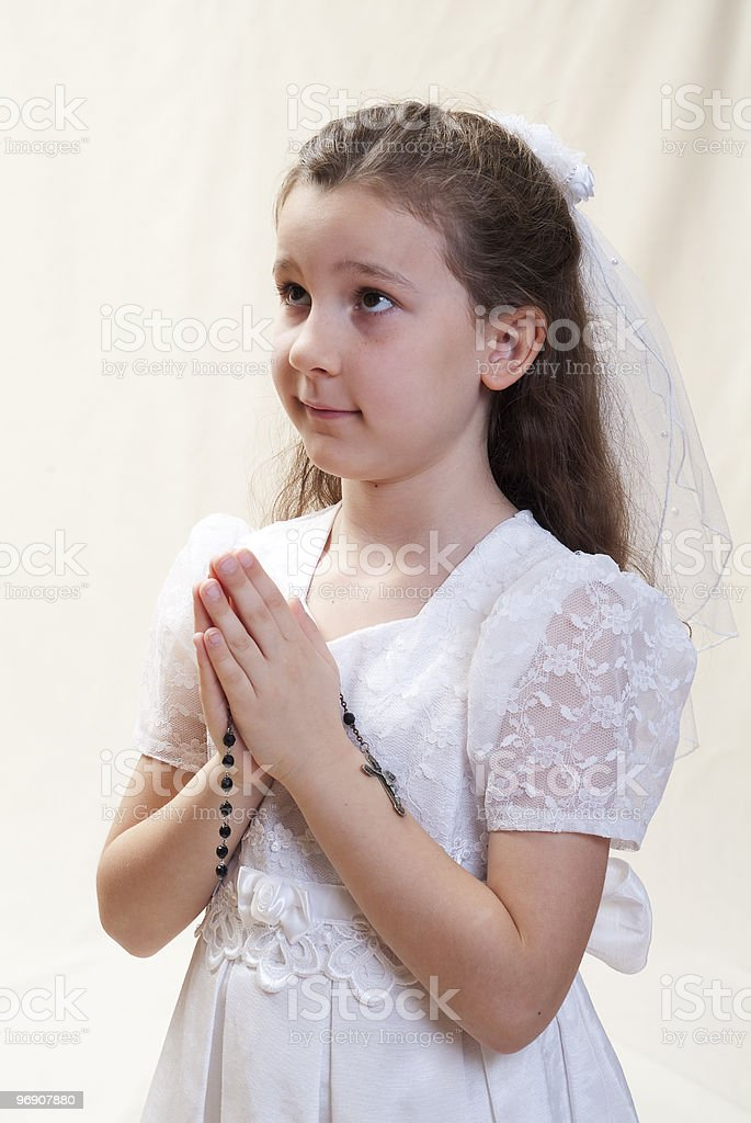 Young girl's first communion, holding a rosary royalty-free stock photo