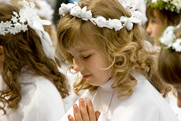 young girls first holy communion - communion stock photos and pictures