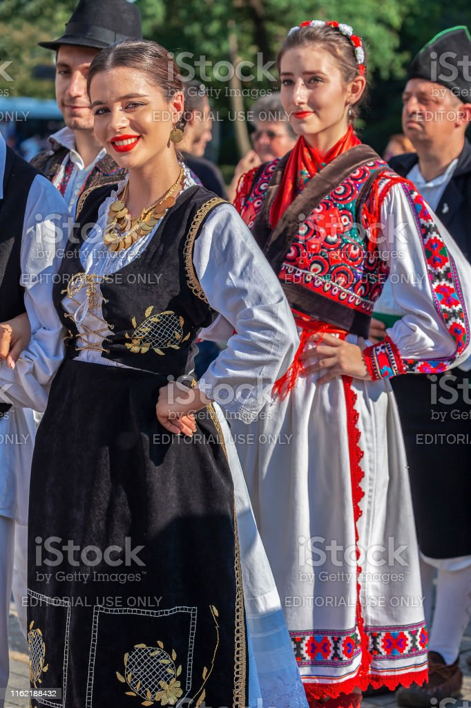 Young girls from Romania in traditional costume, present at the...