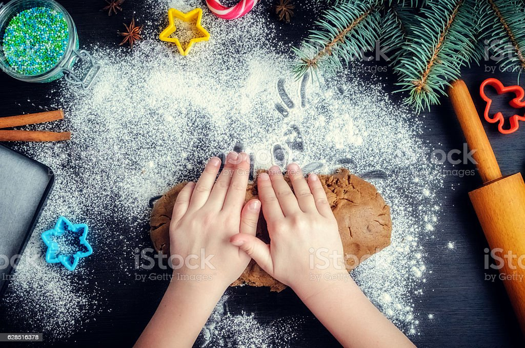 Young girl's hands kneading dough stock photo
