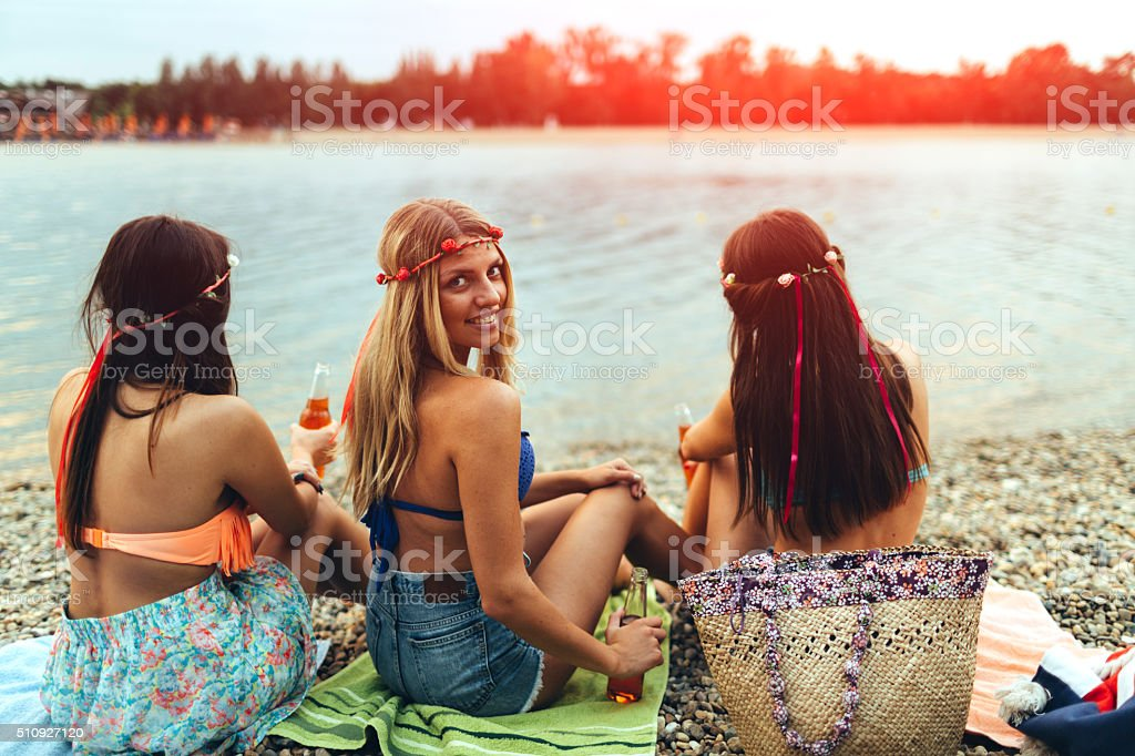 Young Girls Having Fun On The Beach. stock photo
