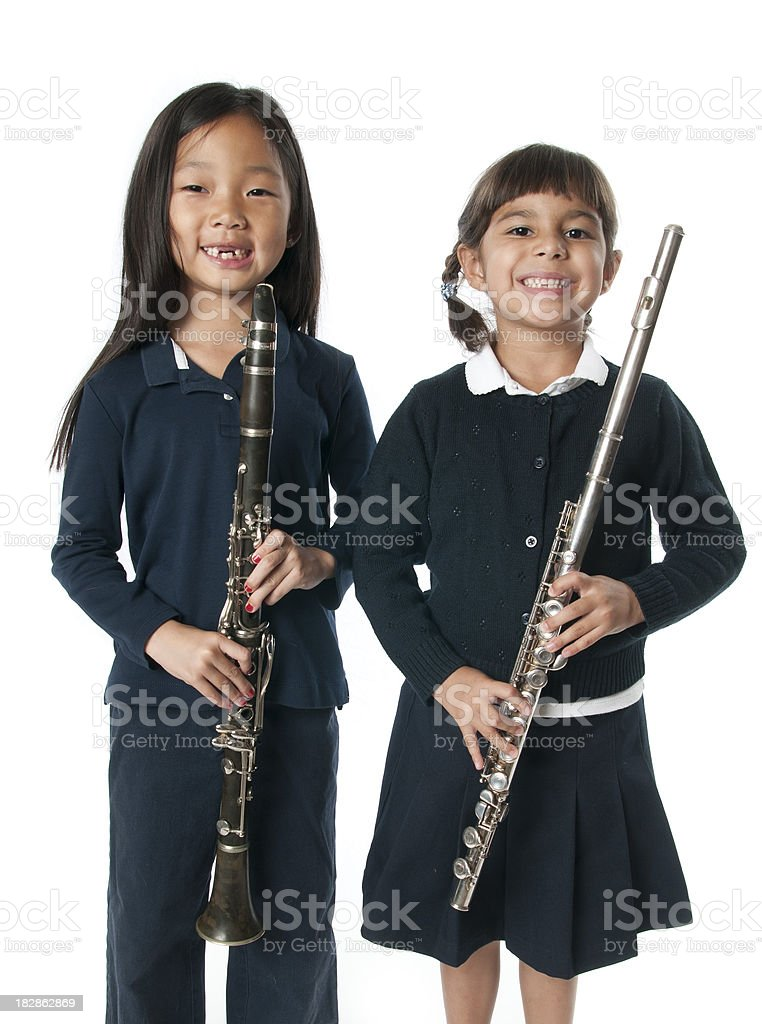 Young girls holding musical Instruments royalty-free stock photo