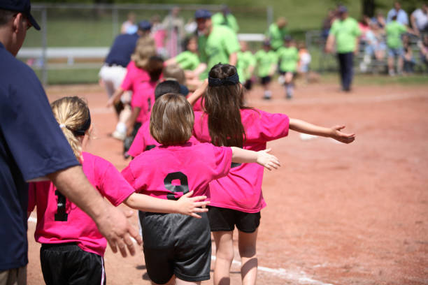 Young girls in pink and black sports gear playing outside stock photo