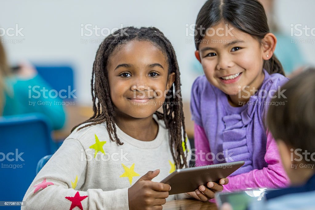 Young Girls Learning How to Write Code stock photo