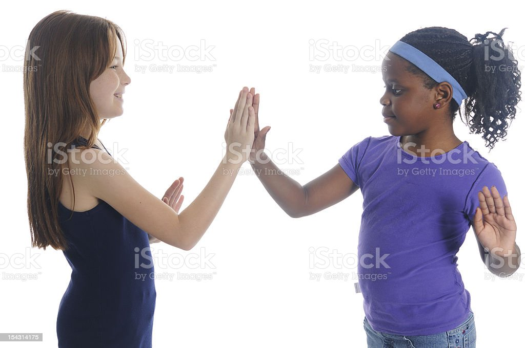 Young Girls Play Patty Cake royalty-free stock photo
