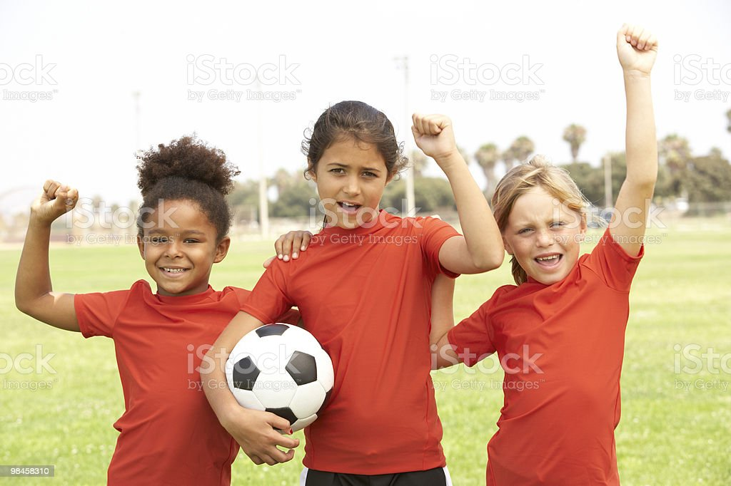 Young girls playing on a football team royalty-free stock photo