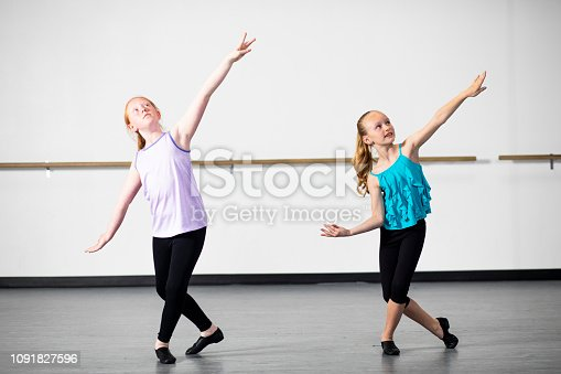 istock Young Girls Practicing Musical Theatre Dance in Studio 1091827596