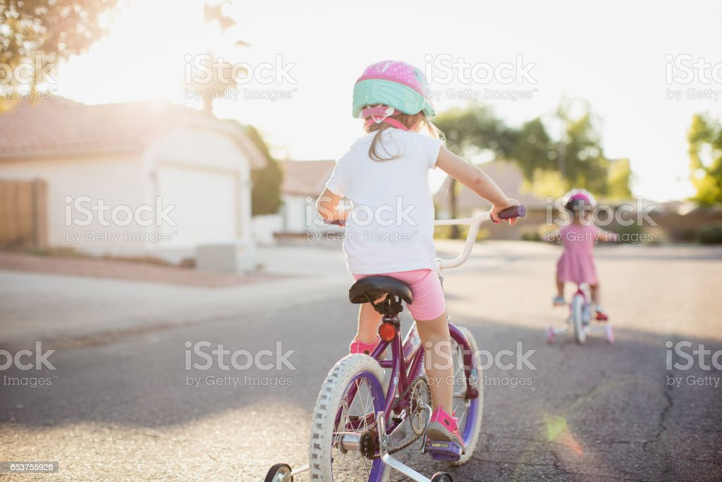 Young Girls Riding Bikes stock photo