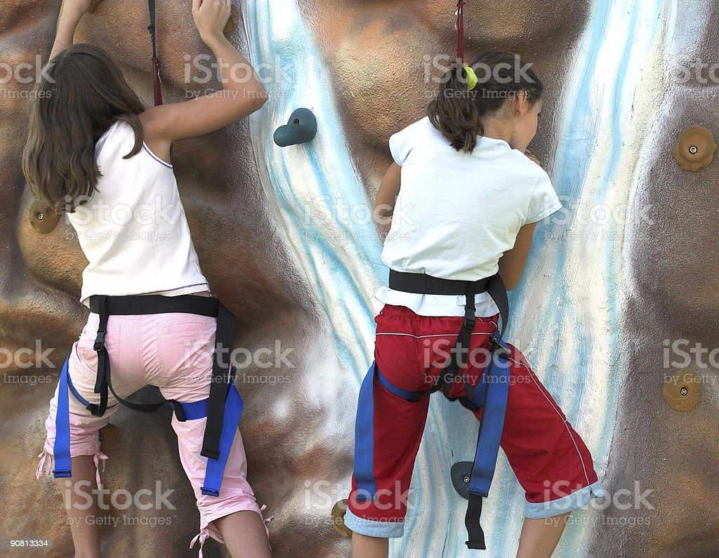 Young Girls Rock Climbing stock photo