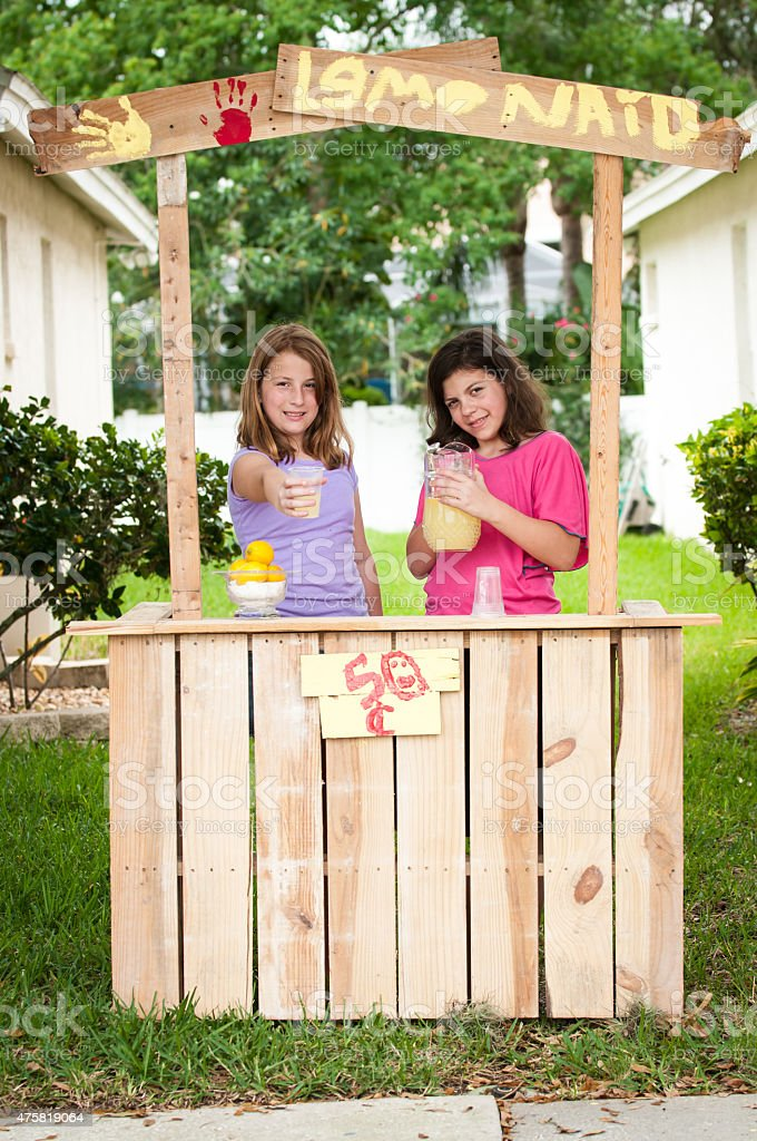 Young girls selling lemonade stock photo