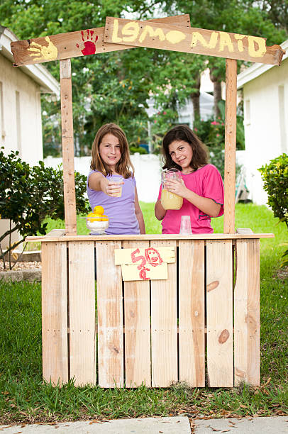 Young girls selling lemonade stock photo